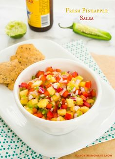 Fresh Pineapple Salsa is a south of the border meets tropical salsa that's sweet, spicy, fresh, and savory. It's the perfect accompaniment to chips, grilled chicken, fish, or tacos!