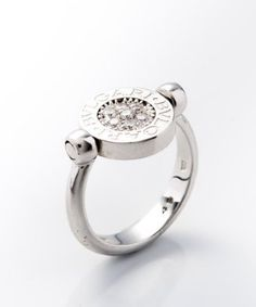 Bulgari:  white gold and diamond 'Flip' vintage ring