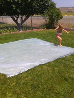 (plastic drop cloth 10′x20′ in size. finished size 10′x10′. big wide long roll of duct tape) Lay your plastic sheeting out flat & fold it in half,  Start taping the open edges together to close it off.  I found that it didn't leak as badly where I folded the edges (like a hem before you sew).  Tape everything up except for where the hose will go in. Start filling it up with water, then take the hose out and tape up the hose hole. check edges for leaks and repair them with more tape if…