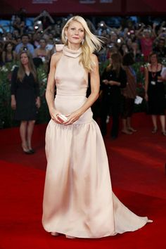 Gwyneth Paltrow poses in pink Prada at Venice Film Festival