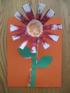 Paper cup flowers. Great way to practice snipping with little ones.