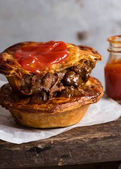 Two homemade Australian Meat Pies with tomato sauce, ready to be eaten dishes Meat Pie recipe! Quiches, Mincemeat Pie, Beef Pies, Tapas, Recipe Tin, Pastry Recipe, Recipetin Eats, Shortcrust Pastry, Meat Recipes