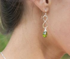 Hey, I found this really awesome Etsy listing at http://www.etsy.com/listing/154534927/silver-infinity-earrings-green-peridot