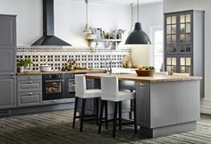 Ikea Kitchen Cabinets I like the color scheme here. Not the lighting or the hood, but I like the grey cabinets with the black appliances Grey Ikea Kitchen, Ikea Kitchen Cabinets, Grey Cabinets, New Kitchen, Kitchen Decor, Kitchen Ideas, Kitchen Designs, Kitchen Storage, Kitchen Tile