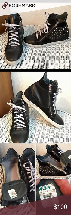 Black studded high top wedge These are a fun and funky update to a plain pair of sneakers!   These lace up/zipper on & off hidden wedge studded sneakers will have you in fashion! *Worn twice. Shoes Sneakers