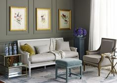 """Classic gold frames from Framebridge pop against the muted olive walls.  The soft, rich look of matte paint makes it perfect for plush sitting rooms and dreamy bedrooms, says Chuber, noting that the velvety finish especially highlights artwork and wall decor. """"Polished fixtures and metallics really pop against a matte backdrop,"""" she says. """"The flat finish provides a contrast to the glossy surface of picture frames, bringing an added elegance to a gallery wall."""""""