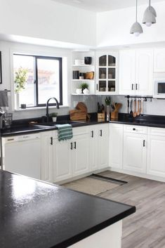 This stunning modern kitchen was transformed in just one weekend! Love the design ideas in this stunning black and white kitchen! The kitchen features white cabinets black countertops black hardware matte black faucet black sink and wood accents Modern Kitchen Cabinets, Modern Kitchen Design, Kitchen Backsplash, Gray Cabinets, White Appliances In Kitchen, White Cabinet Kitchen, Kitchen Black Counter, Corner Cabinets, Corner Sink