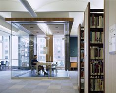 Mount Prospect Public Library - glass-encased study rooms provide access to daylight and acoustical separation