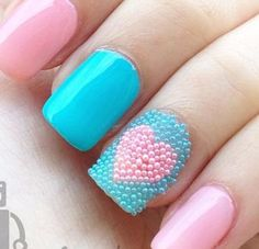 Pastel Pink and Blue Nails complete with beads and a heart.