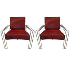 Pair of Italian Chrome Club Chairs with Pony Hair Upholstery | From a unique collection of antique and modern club chairs at https://www.1stdibs.com/furniture/seating/club-chairs/