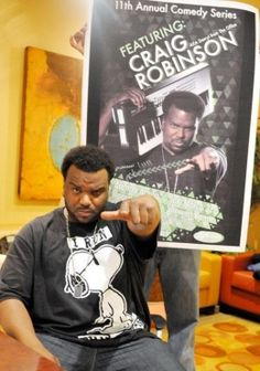 """Craig Robinson (from """"The Office"""") in a Snoopy t-shirt"""