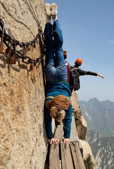 Crazy chick does a crazy trick: Handstands on Mt Huashan