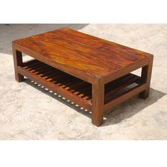 This lovely hardwood coffee table blends with today's modern styles and eco-friendly designs. The open slat bottom shelf adds a delightful contrast to the simple, solid table top. The square legs and hand fitted corners are a celebration of the beauty of simplicity. Indian Sheesham has a dynamic wood grain pattern that is enhanced with a rich honey oak stain.