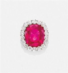 A Rare Burmese Ruby and Diamond Ring     an Burmese cushion-cut ruby, weighing approximately 31.06 carats,