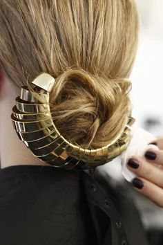 I like this bun with a robotic metal accent to it. Really sleek hair idea, prefect for a fuss free glam up do