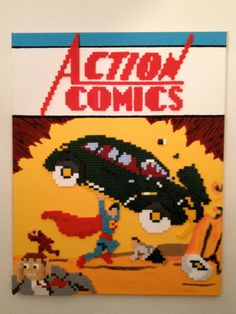 """Action Comics 1 Superman  Perler Bead Pixel Art by ThePixelArtShop. Perler Beads on painted canvas. It measures 16"""" wide and 20"""" tall."""