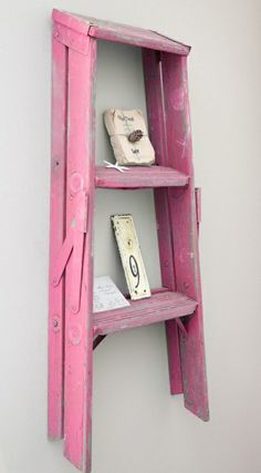 Upcycle old items with a splash of colour to create a unique look for your home - we love these pink stepladder shelves.