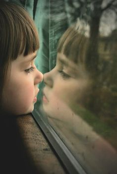 Waiting for Daddy to come home...great photo, I love the reflection.