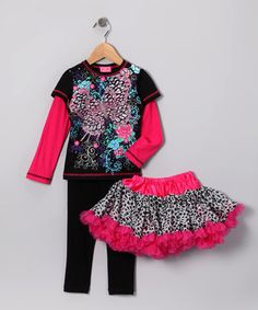 Layers of fluffy tulle and glamorous graffiti graphics twirl into this trendy trio for a snazzy look. Girls with a flair for the glitz and the glam will love mixing and matching the sassy satin pettiskirt and stretchy leggings with the dazzling layered tee.