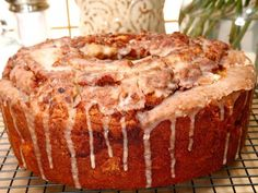This classic coffee cake is filled with pecans, brown sugar, and cinnamon and drizzled with a sweet glaze.