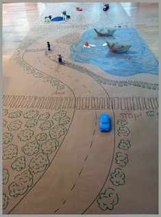 imagination + paper = fun. Let the kids draw the roads then bring in the cars and you got fun