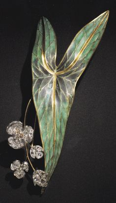 An Art Nouveau gold, enamel and diamond brooch, designed by René Lalique for Henri Vever, 1890-95.
