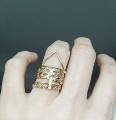 i want everything on this finger. but especially that triangle ring in gold. so so so so so so so so so so so so bad.