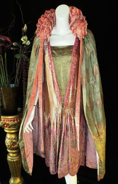 Ellen Colon-Lugo finds a 1920s coat ... lovely to look at and I want to sashay in it. source: https://www.etsy.com/listing/171528584/antique-art-deco-pastel-metallic-lame?ref=sr_gallery_40&ga_search_query=1920*&ga_view_type=gallery&ga_ship_to=ZZ&ga_order=date_desc&ga_page=4&ga_search_type=vintage