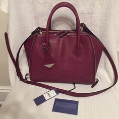"""Rebecca Minkoff Mini perry satchel. In perfect condition only used twice. In color port which is like an Ox blood color. Sold out.I'm In love with it but doesn't really fit into my mommy life. Dimensions are: 10.75""""W x 8.5""""H x 6.5""""D Genuine leather 13.5"""" adjustable detachable shoulder strap drop 5"""" handle drop Custom silver hardware Dual top zipper closure Two exterior expandable zipper slip pockets One interior zipper pocket Three interior slip pocket Custom lining + dust bag.No low balling…"""