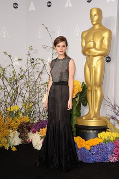 Emma Watson Actress Emma Watson poses in the press room during the Oscars at Loews Hollywood Hotel on March 2, 2014 in Hollywood, California...