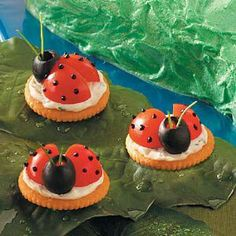 Lady Bug Appetizers  Ingredients 2 ounces cream cheese, softened 2 tablespoons sour cream Black paste food coloring 1/2 teaspoon minced chives 1/8 teaspoon garlic salt 1/8 teaspoon minced fresh parsley 36 butter-flavored crackers 18 cherry tomatoes, quartered 18 large pitted ripe olives 72 fresh chive pieces (about 1-1/2 inches long) Directions In a small bowl, beat cream cheese and sour cream until smooth. Remove 1 tablespoon to a small bowl and tint black. Place tinted cream cheese mixture…