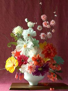 These are made of paper. Beautiful! Paper Crepe Flowers by Livia Cetti