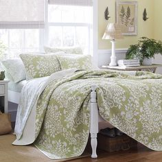 Offering resort-worthy style for your master suite, this reversible cotton quilt set showcases a white floral damask motif atop a sage background.
