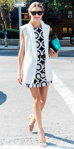 Olivia Palermo took her front-row savant at Desigual in a black-and-white concentric circle-print dress, giving it her signature Palermo-approved spin with a sharp white waistcoat, a black skinny belt, studded shades, a seagreen Roland Mouret purse and nude lace-up Aquazzura sandals.