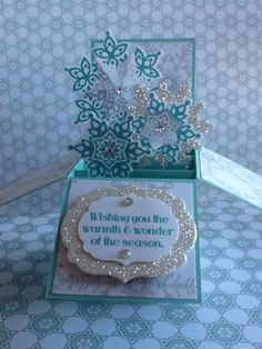 Card in a Box -  Shari van Lankveld, This lovely card comes from a wonderful tutorial by Monica Gale. It folds flat so you can put it in an envelope. It's made using Coastal Cabana card stock and ink, silver glimmer paper and ink, Winter Frost dsp, Festive Flurry stamps and framelits and the words are from the hostess stamp set Warmth and Wonder.