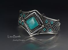 Here is my latest attempt at marrying metal clay with wire work. Turquoise bezel set in fine silver metal clay with a hand woven sterling bracelet to fit it. --Lisa Barth