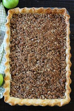 Apple Slab Pie with Crumb Topping Recipe on twopeasandtheirpod.com This easy apple pie is made in a jelly roll pan and is perfect for feeding a crowd. It is our family's favorite dessert.