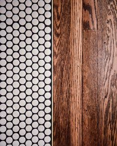 clé loves floor transitions between tile and wood. here is a fantastic close up of penny round tiles transitioning into wood. we offer two types of penny-round tiles, gloss and matte. which one would you choose for your floor tile installation? Penny Floor, Penny Tiles Kitchen, Penny Round Tile Bathroom, Tile Installation, Penny Round Tiles, Penny Tiles Bathroom, Tile To Wood Transition, Flooring, Tile Bathroom
