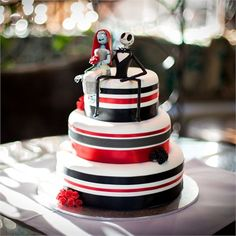 David and Amanda had a three tiered chocolate mud cake, covered in white icing and decorated with black and red ribbon as their wedding cake. The Nightmare Before Christmas touches continued with a Jack and Sally cake topper, which the couple plan to make into a decoration for their home.The cake was made by the bride's aunt, and was served up as dessert at the reception.