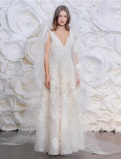 This Naeem Khan Spain FB197 wedding dress is such an elegant, gorgeous gown! The corded floral lace is amazing in person! Not only is this gown gorgeous,