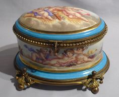Antique French porcelain and ormolu casket with hand painted scenes of cupids.. - Gavin Douglas Antiques