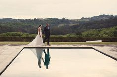 Hello May Magazine  |  A JOYOUS BYRON BAY WEDDING: SIMONE & SHANE -  I love this photo with the reflection. A wedding photographer's dream.
