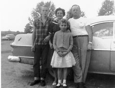 50's farm family ... like the cardigan on the little girl and the button down on the son... clothing ops for the kids...