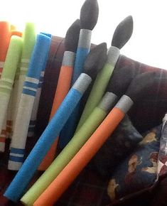 Enlarged paint brushes: made out of pool noodles, and carved floral foam blocks. For the Art Party Maker Fun Factory Vbs, Pool Noodle Crafts, Vacation Bible School, Art Birthday, School Decorations, Art Party, Art Classroom, Elementary Art, Teaching Art