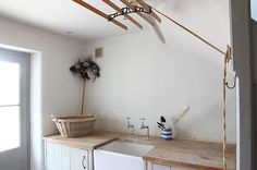 Steal This Look: Simple Summer Laundry Room (Remodelista: Sourcebook for the Considered Home) Scandinavian Style, Laundry Room Lighting, Paper Mulberry, Laundry Rack, Clothes Drying Racks, Clothes Dryer, Laundry Room Inspiration, Utility Sink, Utility Cupboard