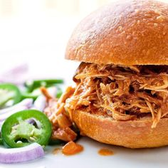This BBQ pulled chicken recipe is a fanciful reinterpretation of pulled pork that slow-cooks chicken in lots of tangy tomato sauce. Have sliced jalapenos, sliced red onions and some sour cream on hand to top this barbecue pulled chicken, which makes a hearty main course. You can turn it into an unbelievable sandwich or serve it on mashed potatoes or even whole-grain spaghetti. Serve with shredded napa cabbage tossed with low-fat mayonnaise, cider vinegar, celery seed and honey to taste.