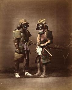 Two samurai in full armor with swords (and face masks), ca. 1870 by Raimund Stillfried von Rathenitz