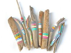 collection of paint adorned twigs and driftwood