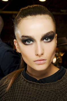 Donna Karan - Oily-looking smoky eyes were created with black all over the lids and almost up to the brows.