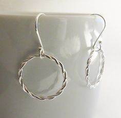 Rope Infinity Twist Silver Earrings via Sirrý Design. Click on the image to see more!